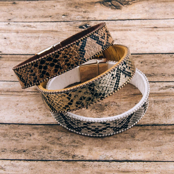 """Faux leather metallic snakeskin magnetic bracelet. Approximately 3"""" in diameter. Fits up to a 6"""" wrist."""