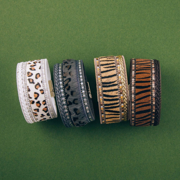 """Faux leather fur tiger stripe magnetic bracelet. Approximately 3.5"""" in diameter, 1"""" in width. Fits up to a 7"""" wrist."""