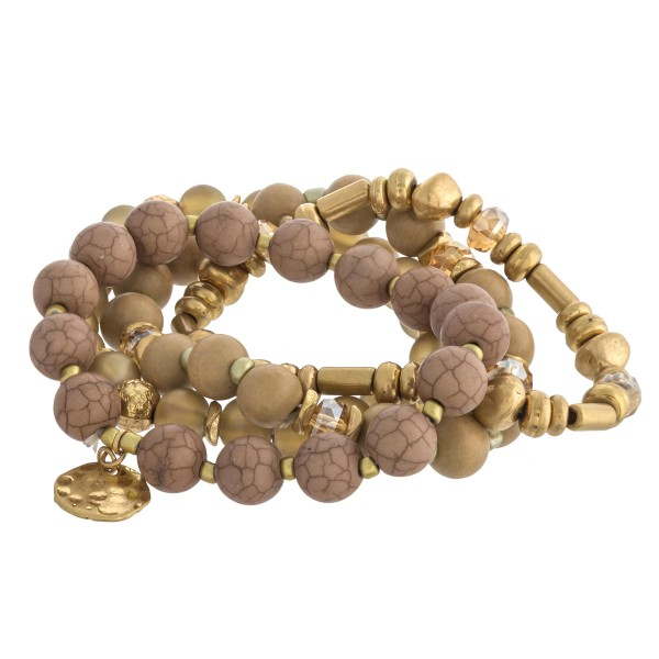 """Semi precious beaded bracelet set of four featuring gold metal accents. Approximately 3"""" in diameter unstretched. Fits up to a 6"""" wrist."""