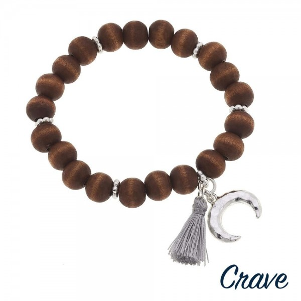 "Wood beaded stretch bracelet with crescent and tassel accents. Approximately 3"" in diameter unstretched. Fits up to a 6"" wrist."
