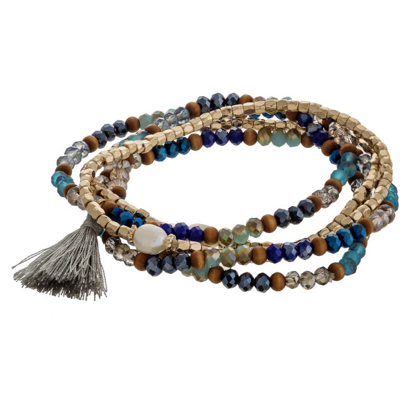"""Multicolor beaded stretch bracelet set with pearl and tassel accents. Approximately 3"""" in diameter unstretched. Fits up to a 6"""" wrist."""