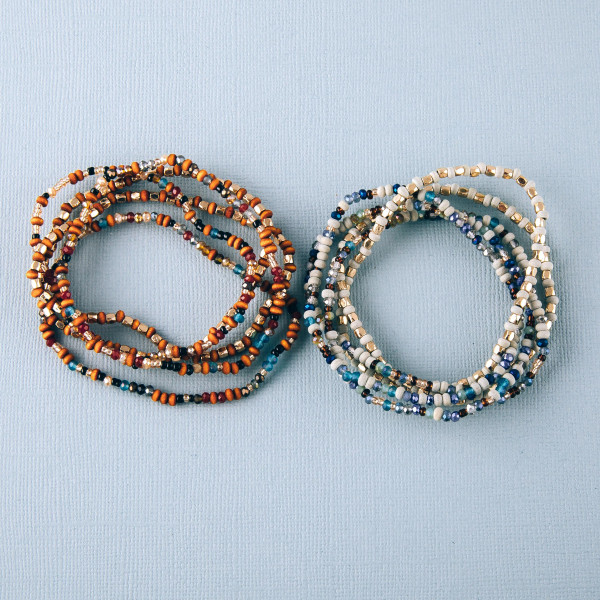 """Seed beaded stretch bracelet set featuring gold and wood accents. Approximately 3"""" in diameter. Fits up to a 6"""" wrist."""