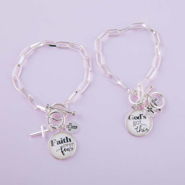 """Chain linked toggle clasp charm bracelet featuring round dome """"Faith Over Fear"""" illustration details. Approximately 3"""" in diameter. Fits up to a 6"""" wrist."""
