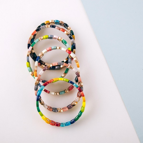 "Enamel color coated metal stretch bracelet.  - Approximately 3"" in diameter unstretched - Fits up to a 6"" wrist"