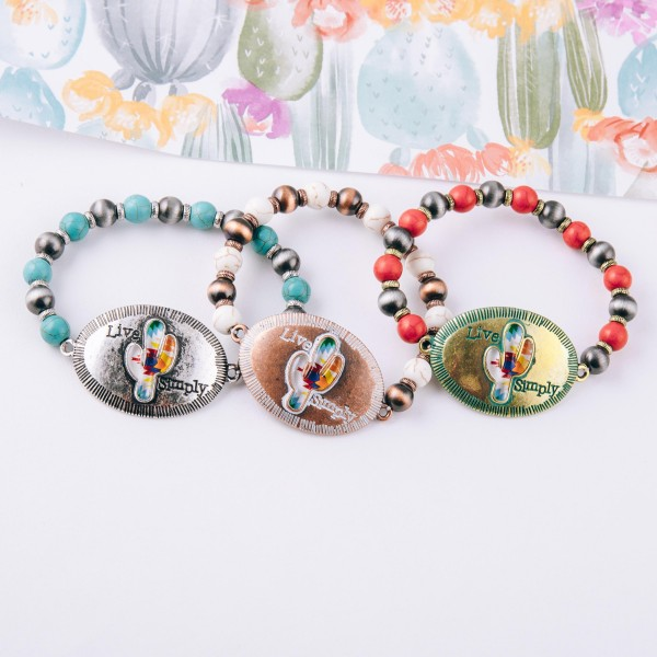 """Semi precious beaded stretch bracelet featuring copper tone focal with """"Live Simply"""" engraved details.  - Approximately 3"""" in diameter unstretched - Fits up to a 6"""" wrist"""