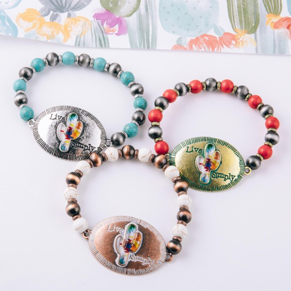 """Semi precious beaded stretch bracelet featuring an antique silver focal with """"Live Simply"""" engraved details.  - Approximately 3"""" in diameter unstretched - Fits up to a 6"""" wrist"""
