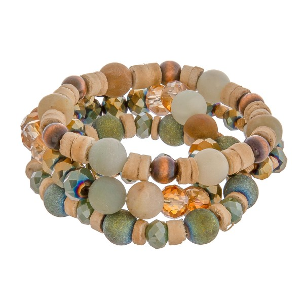 """Semi precious beaded stretch bracelet set of four with wood spacer bead details. Approximately 3"""" in diameter unstetched. Fits up to a 6"""" wrist."""