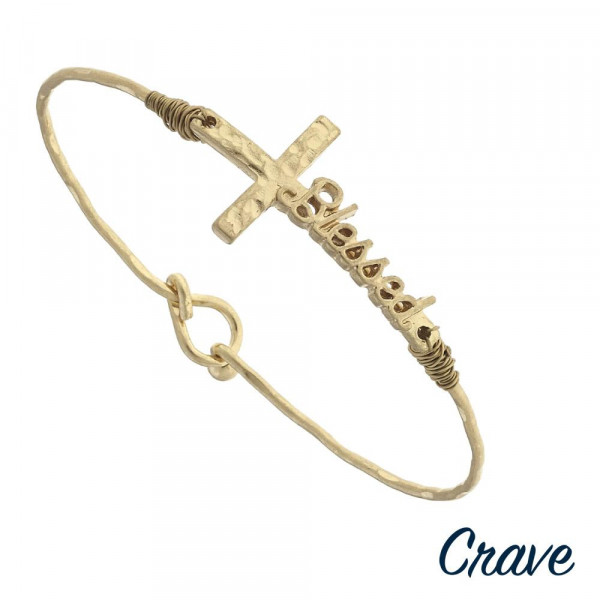 "Gold ""Blessed"" script east west cross bangle bracelet. Approximately 3"" in diameter. Fits up to a 6"" wrist."