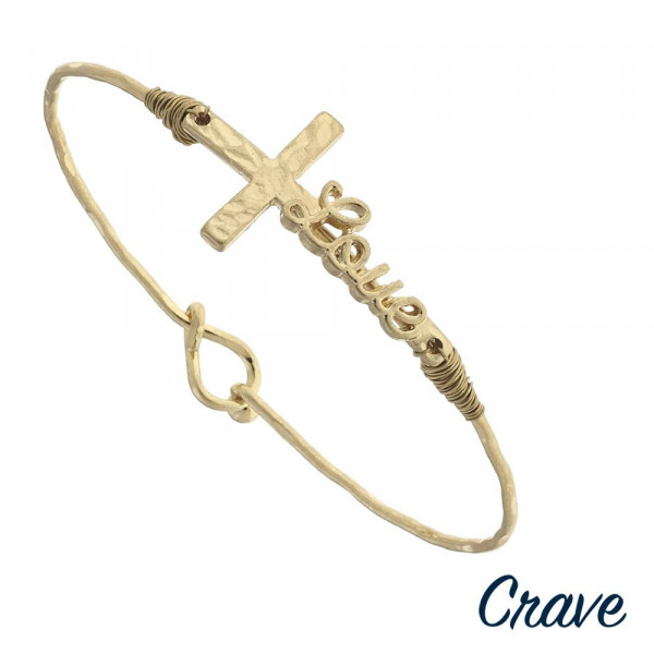 "Gold ""Love"" script east west cross bangle bracelet. Approximately 3"" in diameter. Fits up to a 6"" wrist."