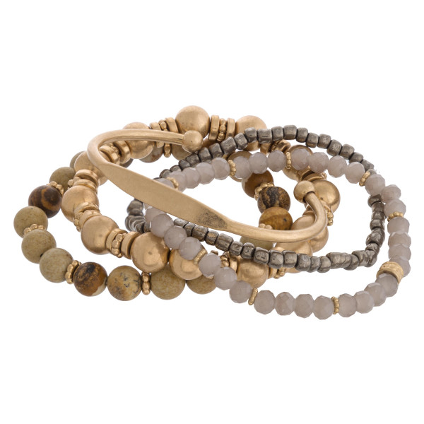 """Semi precious beaded stretch bracelet set featuring a single cuff bracelet and gold accents. Approximately 3"""" in diameter unstretched. Fits up to a 6"""" wrist."""
