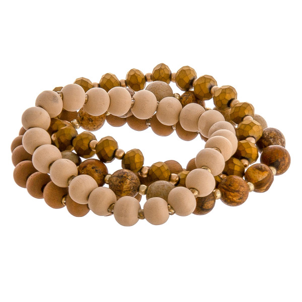 """Matte natural stone wood beaded stretch bracelet set. Approximately 3"""" in diameter. Fits up to a 6"""" wrist."""