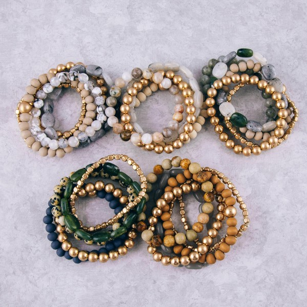 """Semi precious beaded stretch bracelet set of six featuring wood and resin bead details. Approximately 3"""" in diameter unstretched. Fits up to a 6"""" wrist."""