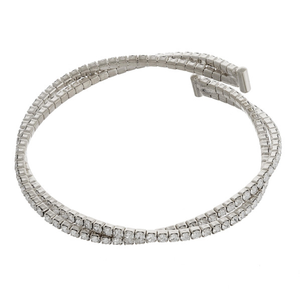 """Twisted cubic zirconia tennis inspired cuff bracelet. Approximately 3"""" in diameter. Fits up to a 6"""" wrist."""