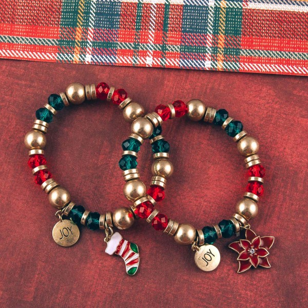 """Christmas charm beaded stretch bracelet. Approximately 3"""" in diameter unstretched. Fits up to a 6"""" wrist."""