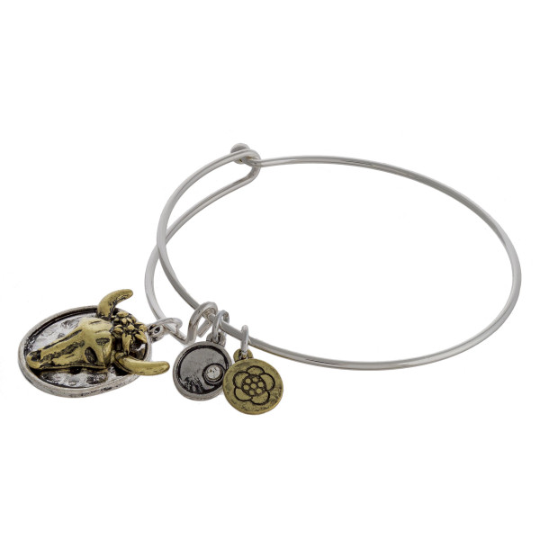 """Two tone cow steer charm bangle bracelet with hook closure. Approximately 3"""" in diameter. Fits up to a 6"""" wrist."""