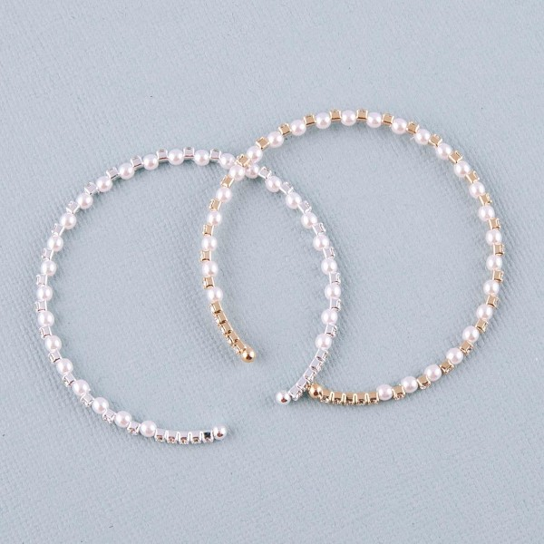 """Cubic zirconia pearl beaded cuff bracelet. Approximately 3"""" in diameter. Fits up to a 6"""" wrist."""
