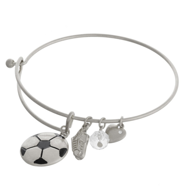 """Silver soccer charm bangle bracelet with hook closure. Approximately 3"""" in diameter. Fits up to a 6"""" wrist."""
