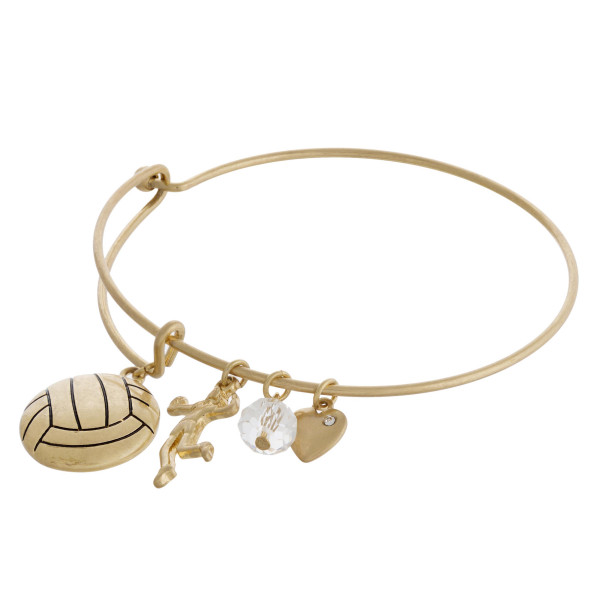 """Gold volleyball charm bangle bracelet with hook closure. Approximately 3"""" in diameter. Fits up to a 6"""" wrist."""