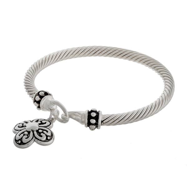 """Filigree flower charm bangle bracelet with hook closure. Approximately 3"""" in diameter. Fits up to a 6"""" wrist."""