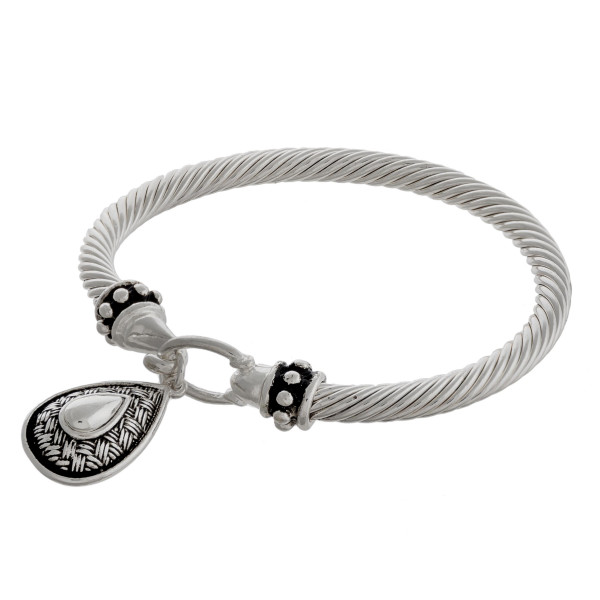 """Teardrop charm bangle bracelet with hook closure. Approximately 3"""" in diameter. Fits up to a 6"""" wrist."""