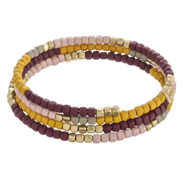 """Multicolor color block beaded wrap cuff bracelet. Approximately 2.5"""" in diameter. Fits up to a 5"""" wrist."""