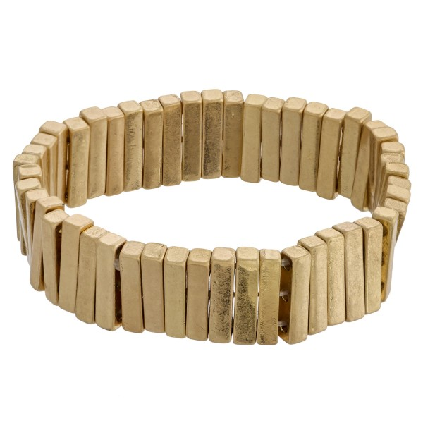 """Metal tone pinstripe stretch bracelet. Approximately 3"""" in diameter unstretched. Fits up to a 6"""" wrist."""