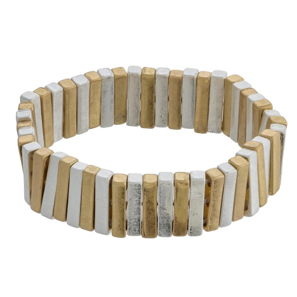 """Two tone metal pinstripe stretch bracelet. Approximately 3"""" in diameter unstretched. Fits up to a 6"""" wrist."""