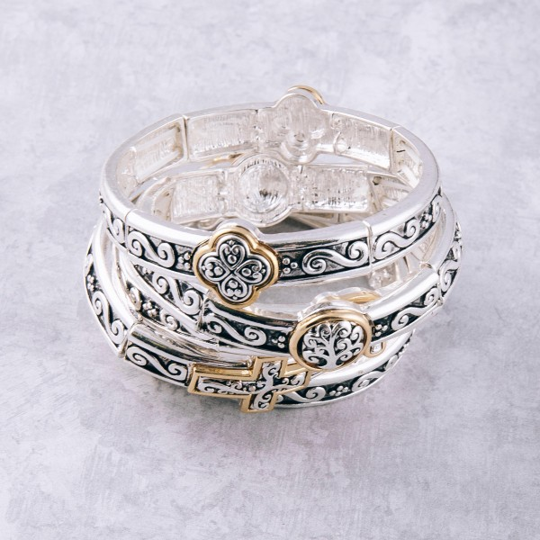 """Two tone antique silver metal cross filigree stretch bracelet. Approximately 3"""" in diameter unstretched. Fits up to a 6"""" wrist."""