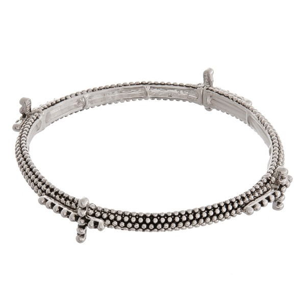 """Antique silver cross metal stretch bracelet.   - Approximately 3"""" in diameter unstretched - Fits up to a 6"""" wrist"""