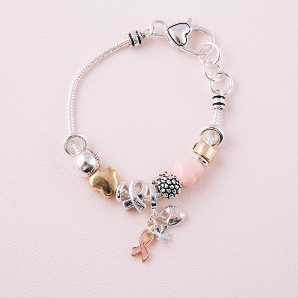 "Two tone Breast Cancer Awareness charm bracelet with a lobster clasp closure. Approximately 3"" in diameter. Fits up to a 6"" wrist."