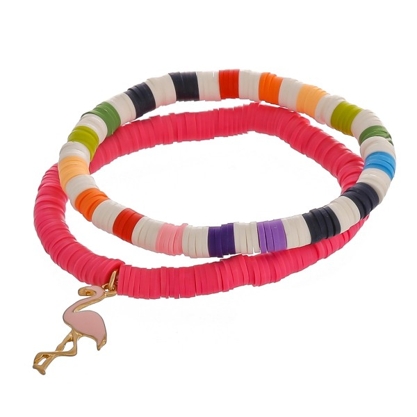 """Spacer beaded stretch bracelet set of two with an enamel coated flamingo charm.  - Approximately 3"""" in diameter unstretched - Fits up to a 6"""" wrist"""