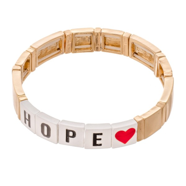 "Gold Tone Enamel Coated Tile ""Hope"" Letter Block Stretch Bracelet with Heart Detail.  - Approximately 3"" in diameter - Fits up to a 7"" wrist"
