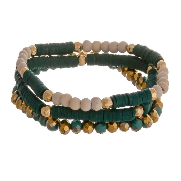 """Wood and spacer beaded stretch bracelet set of three. Approximately 3"""" in diameter unstretched. Fits up to a 6"""" wrist."""