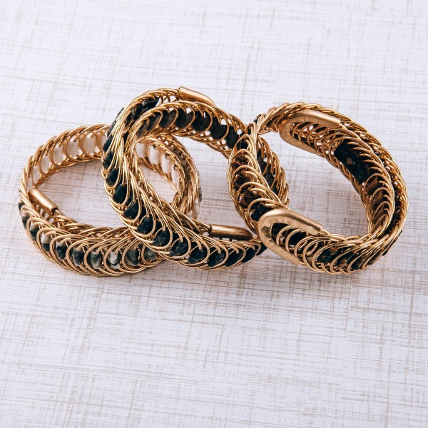 Faux leather snakeskin woven metal wrap bracelet.  - Open fit - One size fits most - Approximately 2cm in width