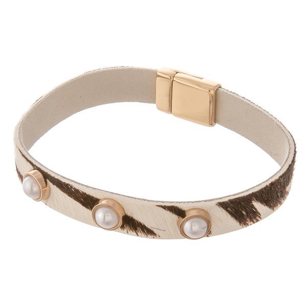 """Cowhide animal print pearl stud magnetic bracelet.  - Magnetic closure - Approximately 3"""" in diameter  - Fits up to a 6"""" wrist"""