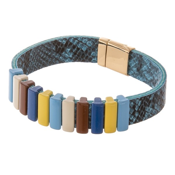 """Faux leather snakeskin color block magnetic bracelet.  - Magnetic clasp - Approximately 3"""" in diameter - Fits up to a 6"""" wrist"""