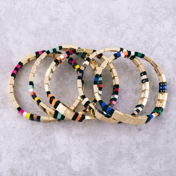 """Gold shiny enamel coated color block stretch bracelet.  - Approximately 3"""" in diameter unstretched - Fits up to a 7"""" wrist"""