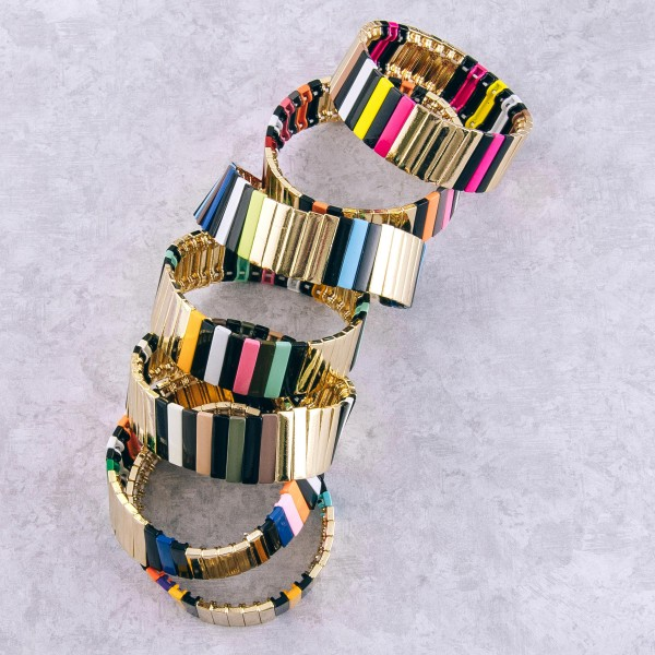 """Gold shiny enamel coated pinstripe color block stretch bracelet.  - Approximately 3"""" in diameter unstretched - Fits up to a 7"""" wrist - .75"""" in width"""