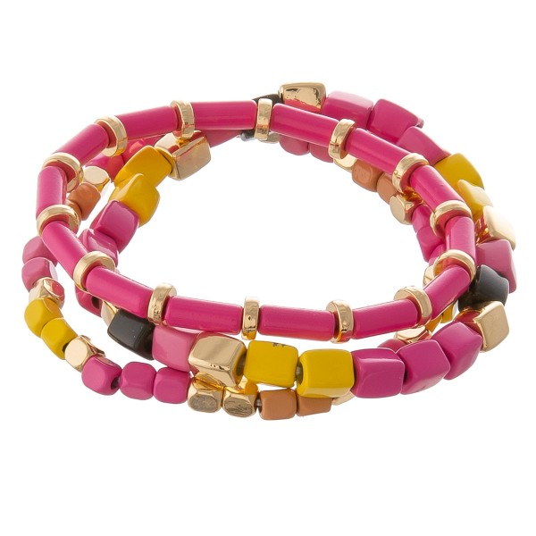 """Shiny enamel coated multi color block beaded stretch bracelet set.  - 3 pcs/pack - Approximately 3"""" in diameter unstretched - Fits up a 7"""" wrist"""
