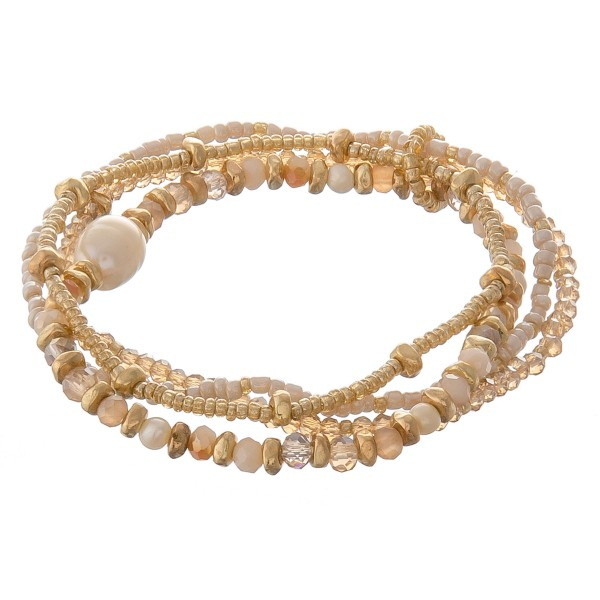 "Multi strand semi precious pearl beaded stretch bracelet set.  - 4pcs/set - Approximately 3"" in diameter unstretched - Fits up to a 7"" wrist"