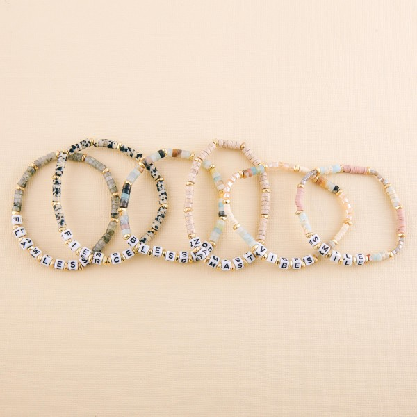 """Semi precious beaded """"Namaste"""" letter stretch bracelet.  - Approximately 3"""" in diameter unstretched - Fits up to a 7"""" wrist"""