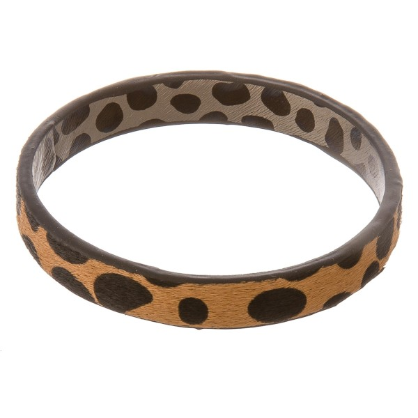 """Genuine leather double sided cow print cowhide bangle bracelet.  - Approximately 3"""" in diameter - Fits up to a 6"""" wrist"""