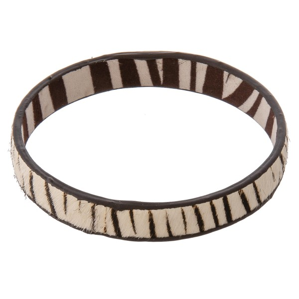 """Genuine leather doubled sided zebra print cowhide bangle bracelet.  - Approximately 3"""" in diameter - Fits up to a 6"""" wrist"""