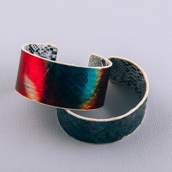 """Genuine leather double sided metallic snakeskin cuff bracelet.  - Approximately 2.75"""" in diameter  - 1.25"""" wide - Fits up to a 6"""" wrist"""
