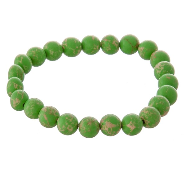 """Beaded stretch natural stone inspired """"Color Therapy"""" bracelet -Color Therapy uses colors and their frequencies to heal and restore emotional balance  -Bracelet measures approximately 3"""" in diameter  -Fits up to a 7"""" wrist -Bead size is approximately 7.5mm in diameter"""