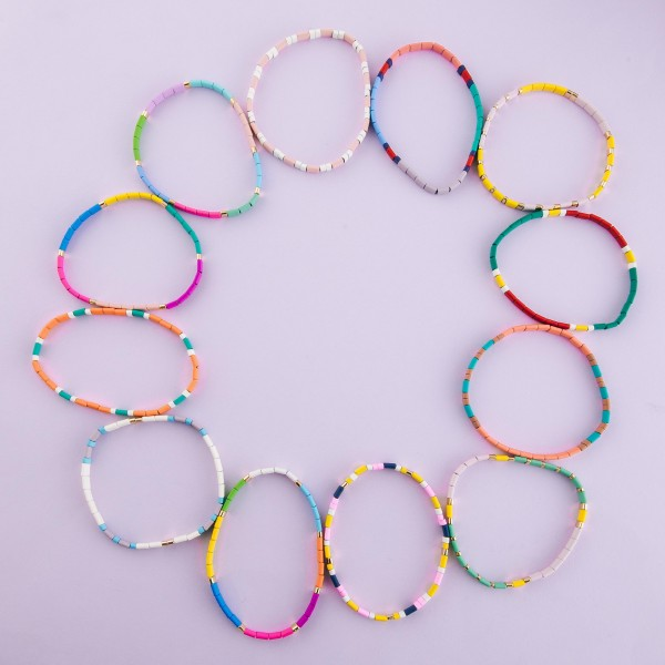 """Miyuki Tila coated beaded stretch bracelet.  - Approximately 3"""" in diameter unstretched - Fits up to a 7"""" wrist"""