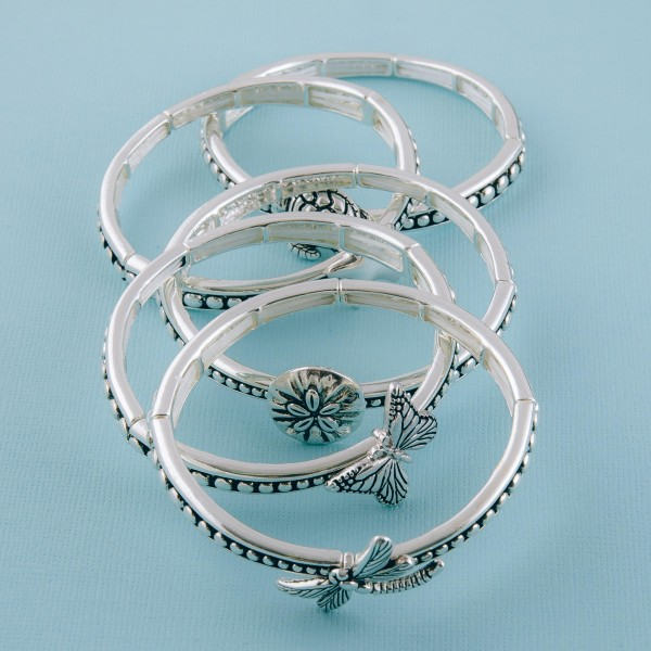 "Antique silver butterfly caviar metal stretch bracelet.  - Approximately 3"" in diameter unstretched - Fits up to a 7"" wrist"