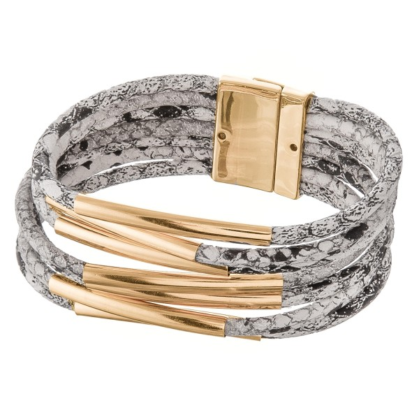 """Faux leather multi strand snakeskin magnetic closure with gold accents.  - Magnetic closure - Approximately 3"""" in diameter - Fits up to a 6"""" wrist"""