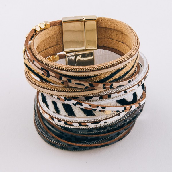 """Faux leather multi strand animal print magnetic bracelet with gold bead accents.  - Magnetic closure - Approximately 3"""" in diameter - Fits up to a 6"""" wrist"""