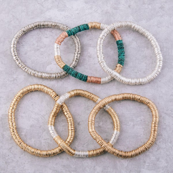 """Metal spacer disc beaded stretch bracelet.  - Approximately 3"""" in diameter unstretched - Fits up to a 7"""" wrist"""